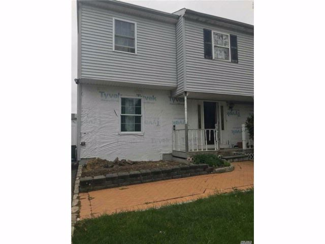 4 BR,  1.50 BTH  Colonial style home in Central Islip