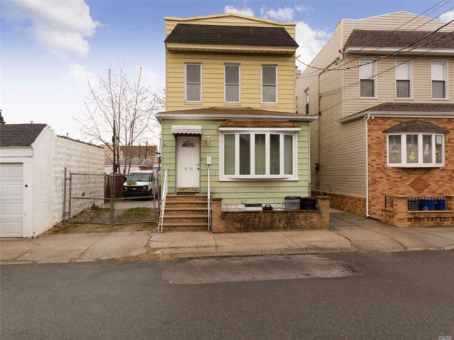 4 BR,  2.00 BTH  Colonial style home in Middle Village