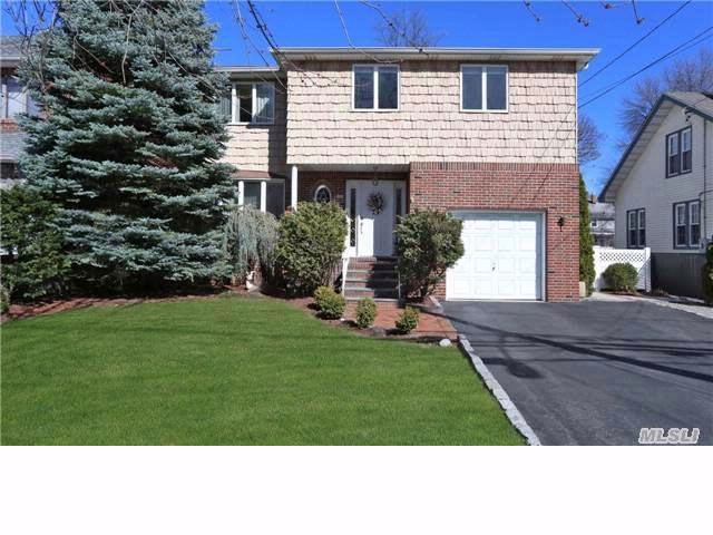 4 BR,  3.50 BTH  Colonial style home in Lynbrook