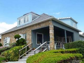 4 BR,  3.50 BTH Mediterranean style home in NEPONSIT