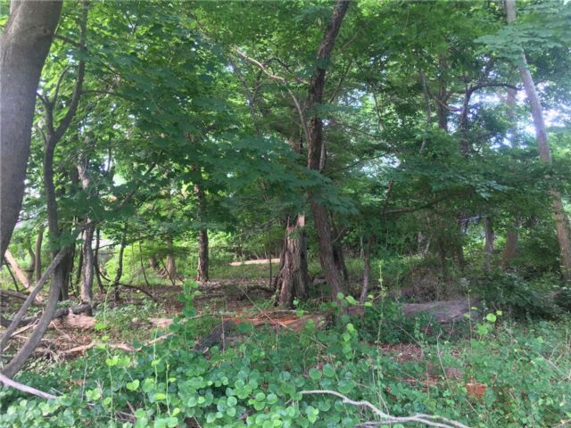 Lot <b>Size:</b> .55 Acre  Land style home in East Islip