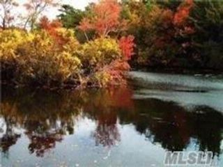 Lot <b>Size:</b> 1.63 & .86 Land style home in Patchogue