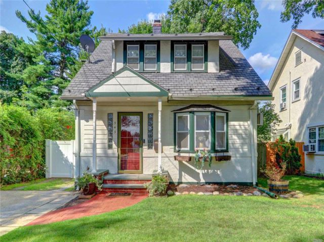 4 BR,  1.50 BTH Colonial style home in Westbury