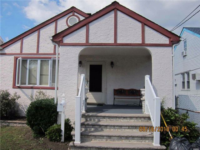4 BR,  1.50 BTH Cape style home in Hempstead