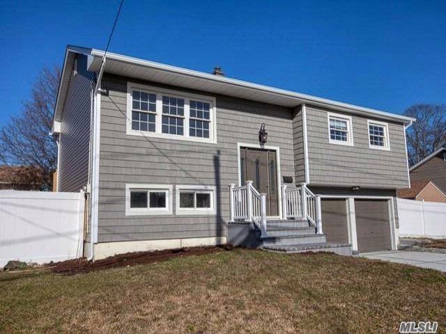 4 BR,  2.00 BTH  Hi ranch style home in Islip Terrace