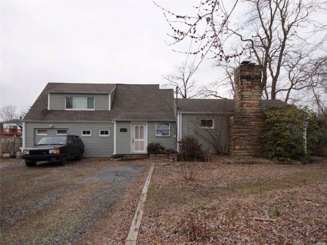Lot <b>Size:</b> .80  Land style home in Dix Hills