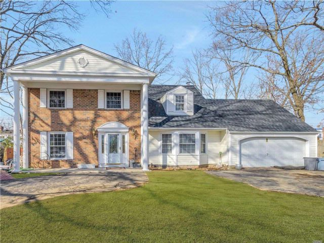 4 BR,  2.50 BTH Colonial style home in Port Jefferson Station