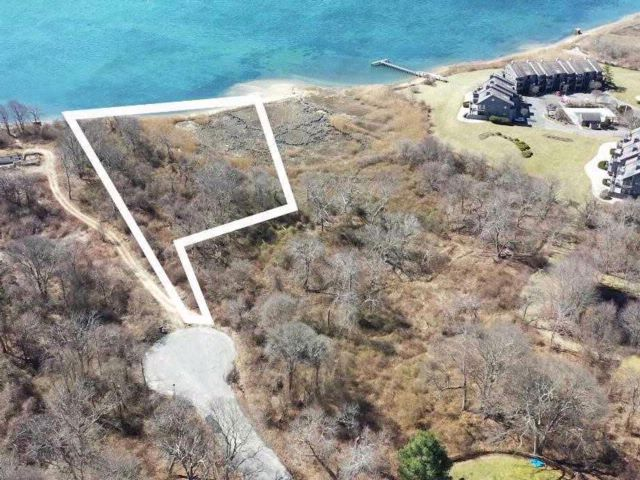 Lot <b>Size:</b> 1.65 Acres  Land style home in East Moriches
