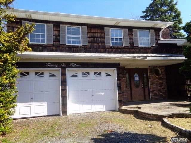 4 BR,  2.50 BTH  Hi ranch style home in Seaford