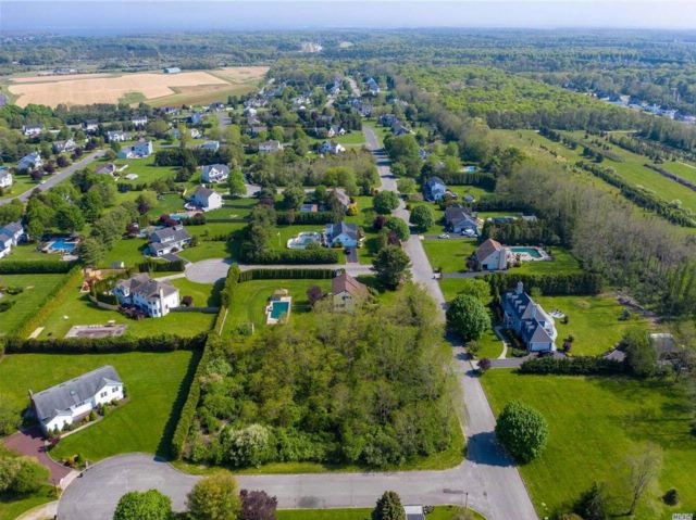 Lot <b>Size:</b> .92  Land style home in Manorville