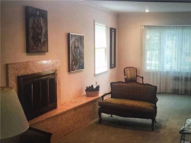 4 BR,  3.50 BTH Colonial style home in Jamaica Estates