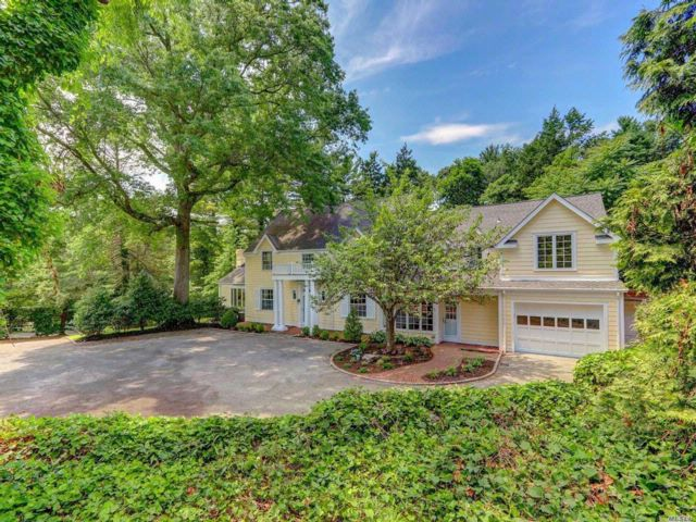 6 BR,  6.50 BTH Colonial style home in Glen Head
