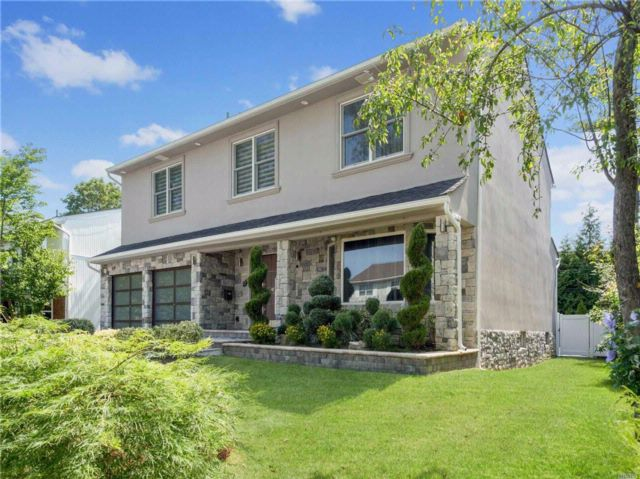 4 BR,  3.00 BTH  Contemporary style home in North Woodmere