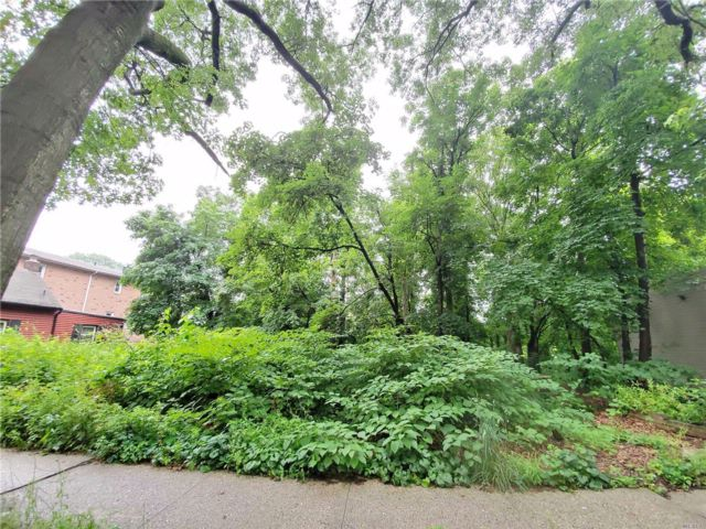 Lot <b>Size:</b> 82.01x182.56 Land style home in Little Neck