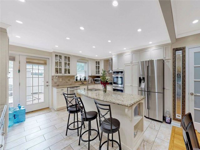 4 BR,  2.55 BTH Colonial style home in Kew Garden Hills