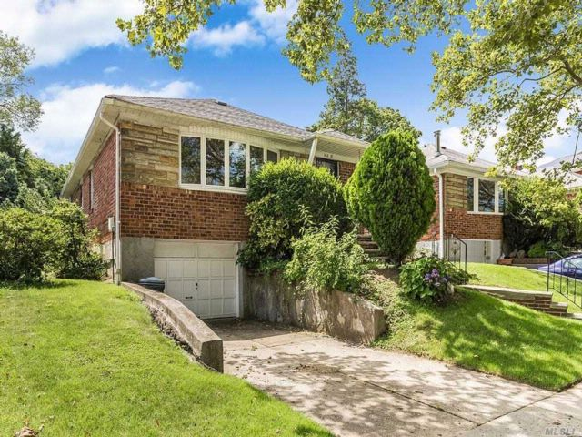 3 BR,  1.55 BTH Raised ranch style home in Little Neck