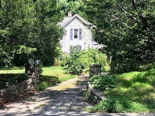 Lot <b>Size:</b> 1 Acre Land style home in Centerport