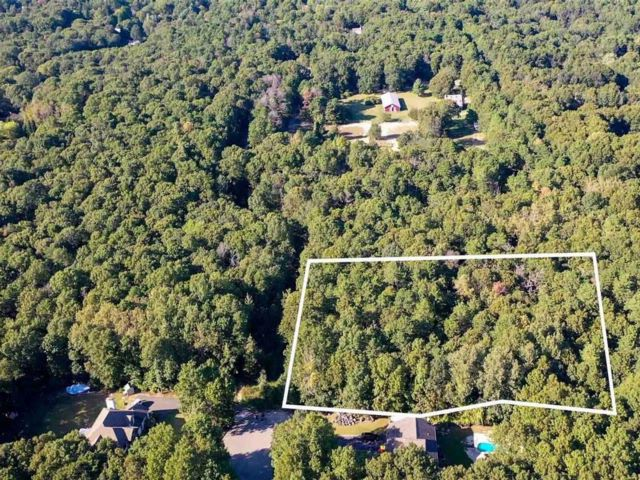 Lot <b>Size:</b> 2.11 Acres  Land style home in Manorville