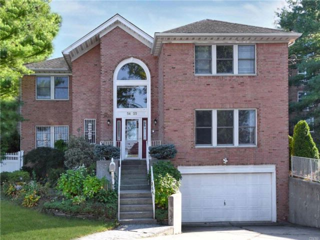 4 BR,  3.50 BTH Colonial style home in Little Neck