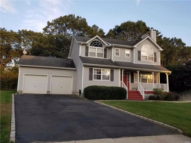 4 BR,  3.50 BTH Colonial style home in Port Jefferson Station