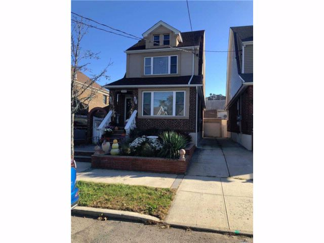 4 BR,  1.50 BTH Colonial style home in Howard Beach