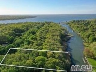 Lot <b>Size:</b> 1.84 Acres  Land style home in East Moriches