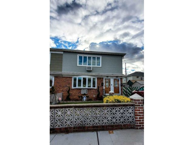 6 BR,  5.00 BTH Duplex style home in Ozone Park