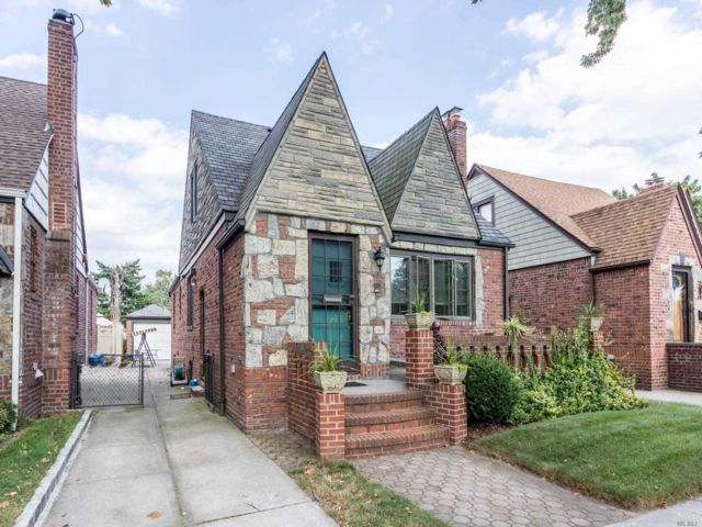 4 BR,  3.00 BTH  Tudor style home in Middle Village