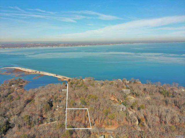 Lot <b>Size:</b> .60 Acre Land style home in Hampton Bays