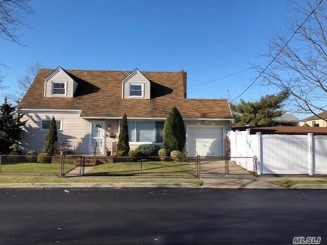 4 BR,  2.00 BTH  Cape style home in Howard Beach