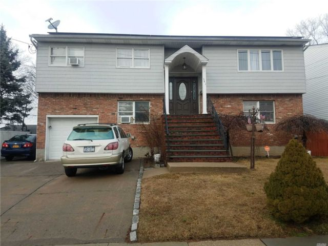 6 BR,  3.00 BTH  Hi ranch style home in West Hempstead