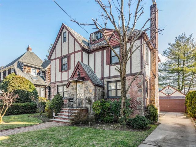 4 BR,  5.00 BTH  Tudor style home in Flushing