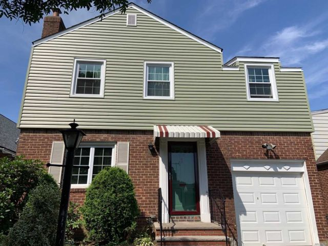 4 BR,  3.00 BTH  Colonial style home in Hollis Hills