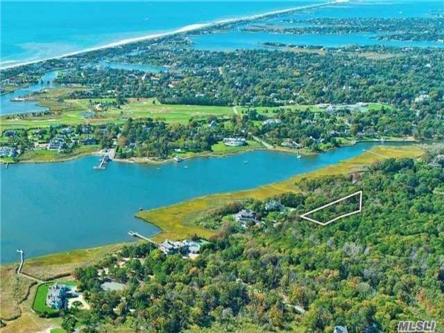Lot <b>Size:</b> 2.29 Acres Land style home in Quogue