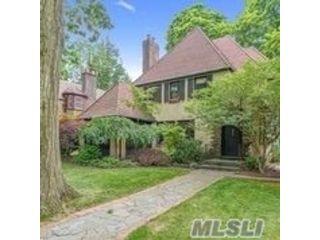 3 BR,  3.00 BTH  Tudor style home in Forest Hills