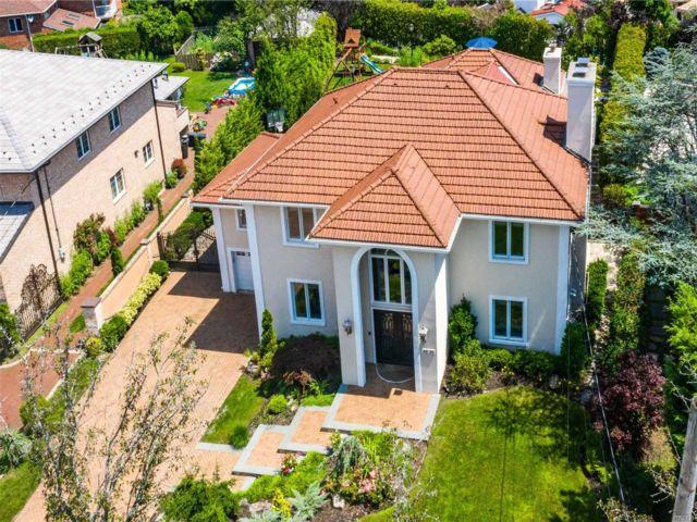 5 BR,  6.00 BTH Mediterranean style home in Little Neck