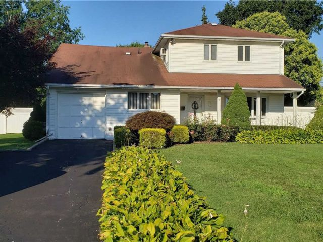 4 BR,  3.00 BTH  Colonial style home in Commack