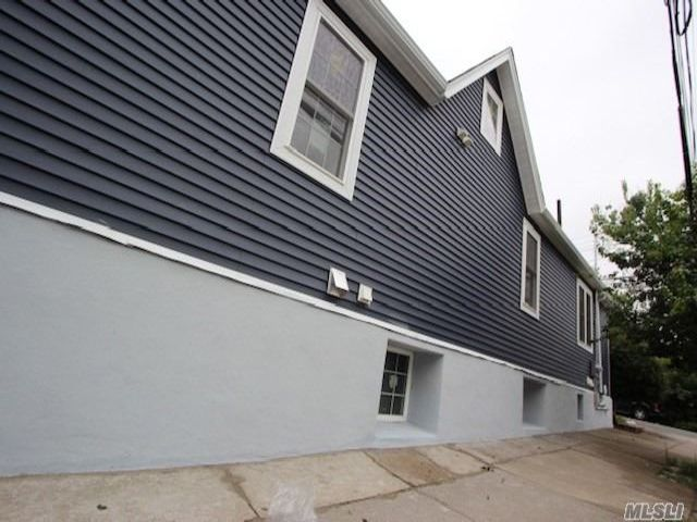 7 BR,  3.00 BTH Cape style home in Middle Village
