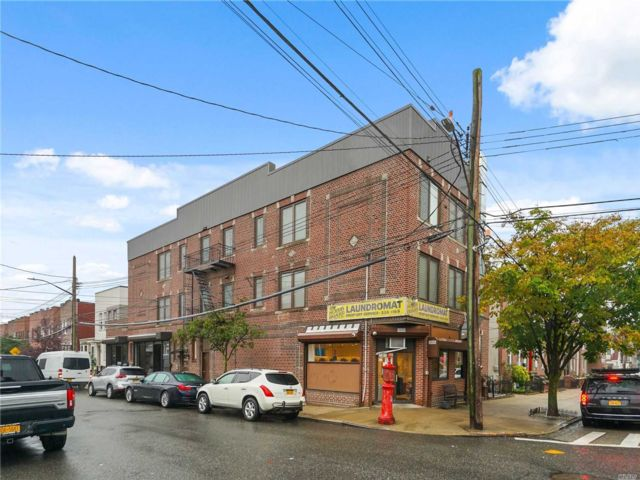 7 BR,  7.00 BTH Store+dwell style home in Middle Village