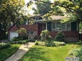 3 BR,  2.00 BTH Split level style home in New Hyde Park
