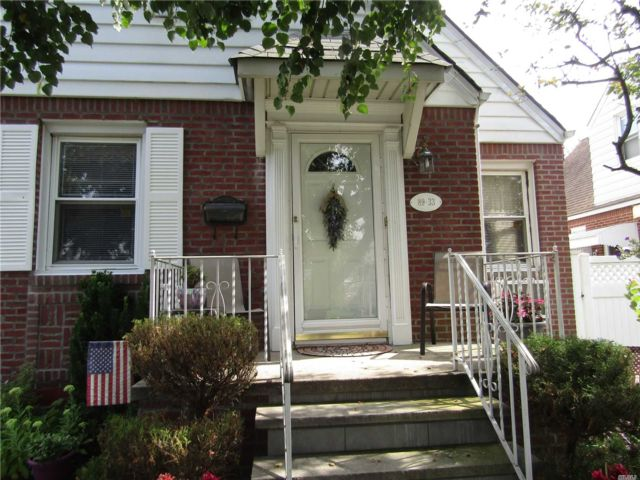 3 BR,  3.00 BTH  Cape style home in Queens Village