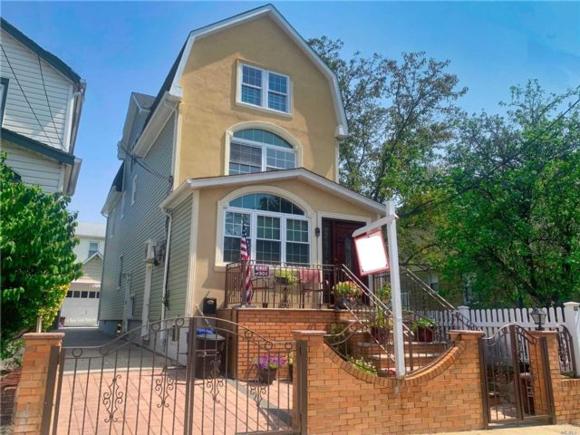 4 BR,  3.00 BTH  Colonial style home in Maspeth