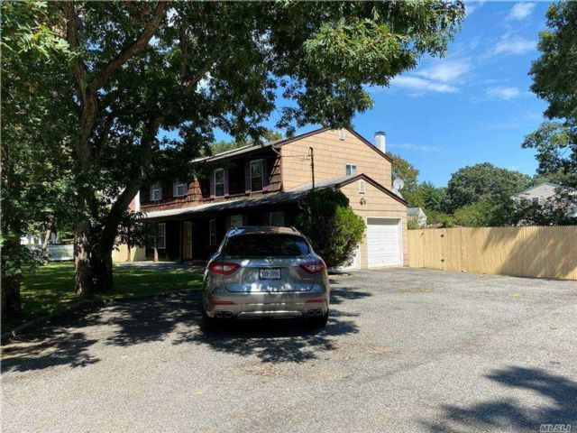7 BR,  3.00 BTH  Colonial style home in Port Jefferson Station