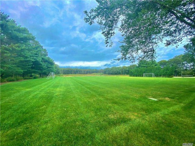 Lot <b>Size:</b> 5.21 Acres Land style home in East Quogue