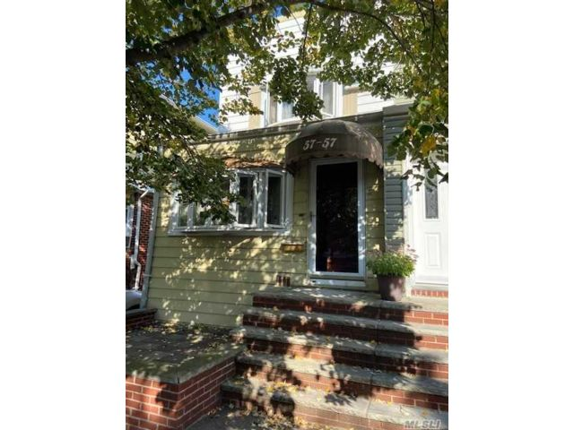 3 BR,  2.00 BTH Colonial style home in Maspeth
