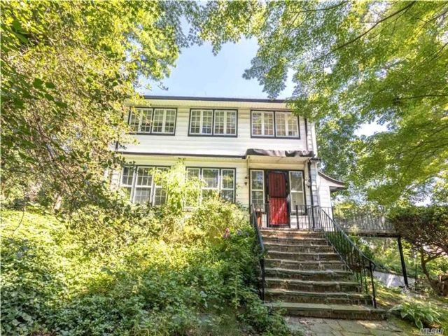 4 BR,  4.00 BTH  Colonial style home in Douglaston