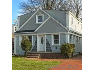 4 BR,  2.00 BTH  Colonial style home in Carle Place