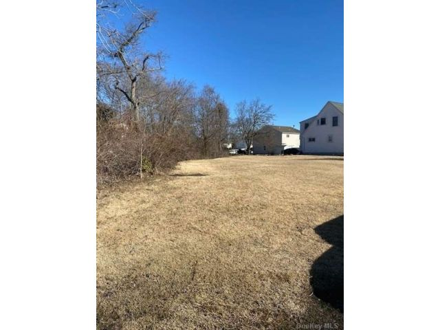 Lot <b>Size:</b> 50x100 Land style home in Copiague