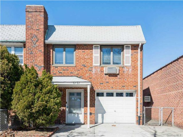 3 BR,  2.00 BTH Semi detached style home in Middle Village