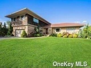 4 BR,  4.00 BTH Mid century mod style home in West Islip